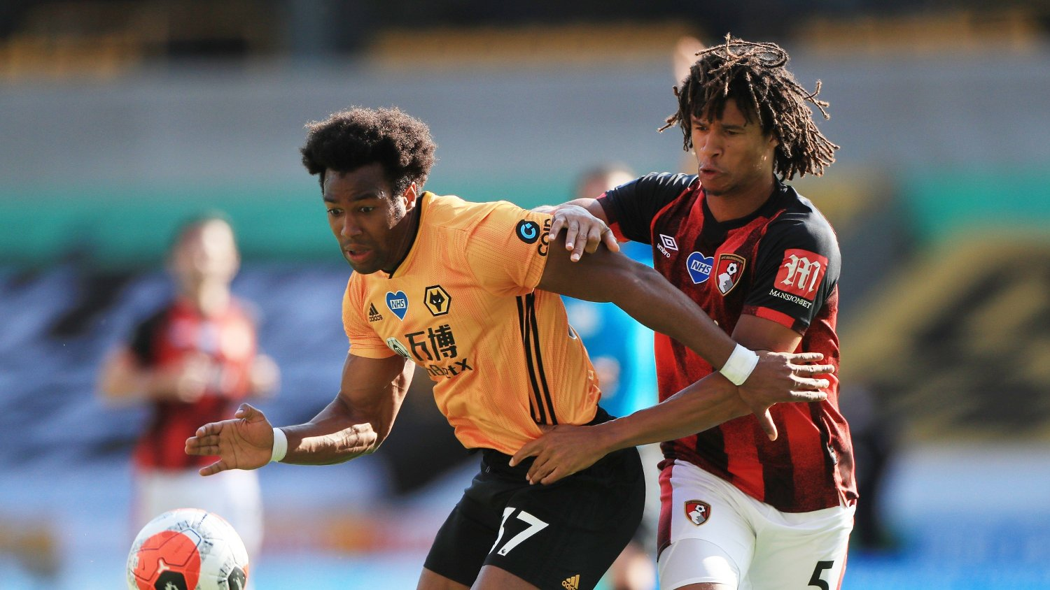 Soccer Football - Premier League - Wolverhampton Wanderers v AFC Bournemouth - Molineux Stadium, Wolverhampton, Britain - June 24, 2020 Wolverhampton Wanderers' Adama Traore in action with Bournemouth's Nathan Ake, as play resumes behind closed doors following the outbreak of the coronavirus disease Mike Egerton/Pool via REUTERS EDITORIAL USE ONLY. No use with unauthorized audio, video, data, fixture lists, club/league logos or