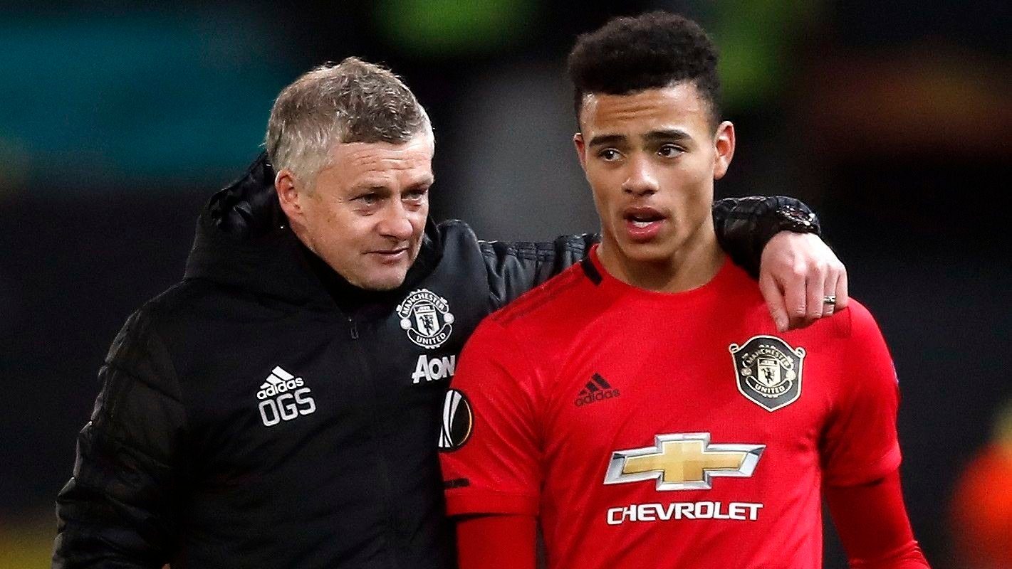 Manchester United manager Ole Gunnar Solskjaer and Mason Greenwood after the final whistle at the Europa League match at Old Trafford, Manchester.
