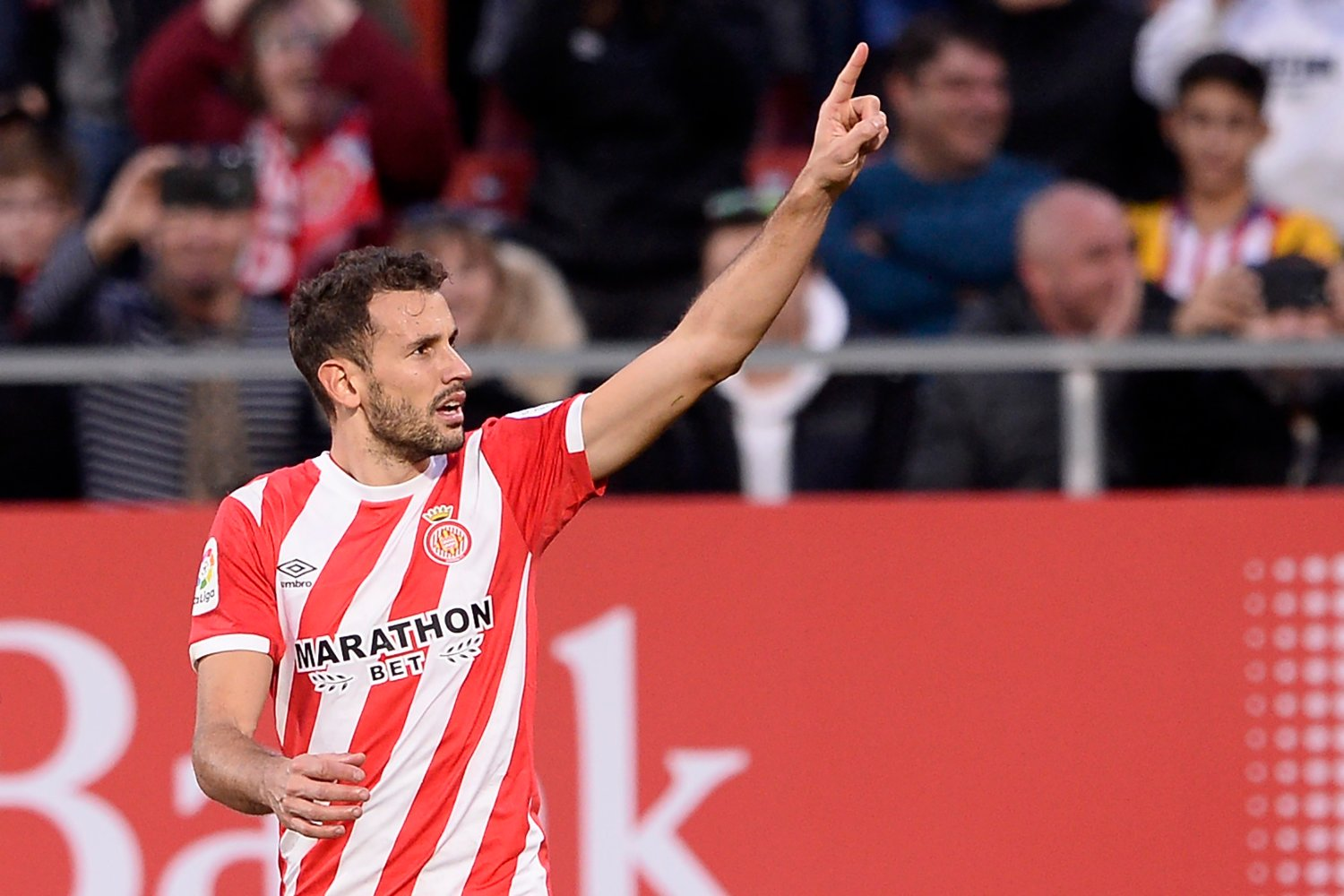 Girona's Uruguayan forward Cristhian Stuani celebrates after scoring a penalty during the Spanish league football match between Girona and Club Atletico de Madrid at the Montilivi stadium in Girona on December 2, 2018.