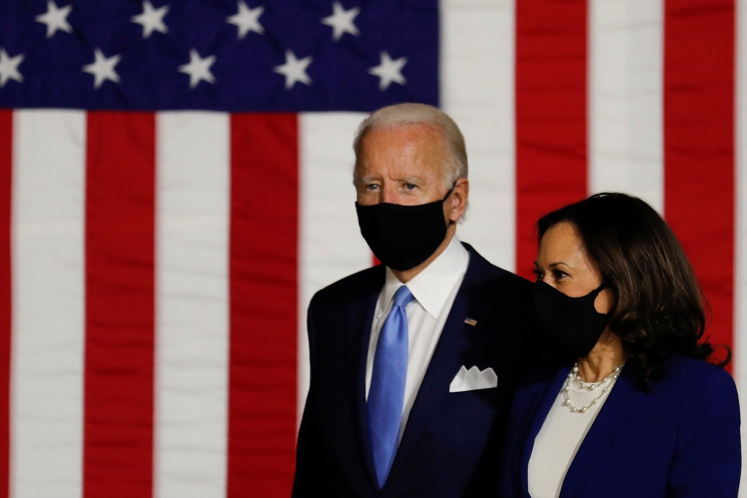 Democratic presidential candidate and former Vice President Joe Biden and vice presidential candidate Senator Kamala Harris take the stage at a campaign event, their first joint appearance since Biden named Harris as his running mate, at Alexis Dupont High School in Wilmington, Delaware, U.S., August 12, 2020. REUTERS/Carlos Barria