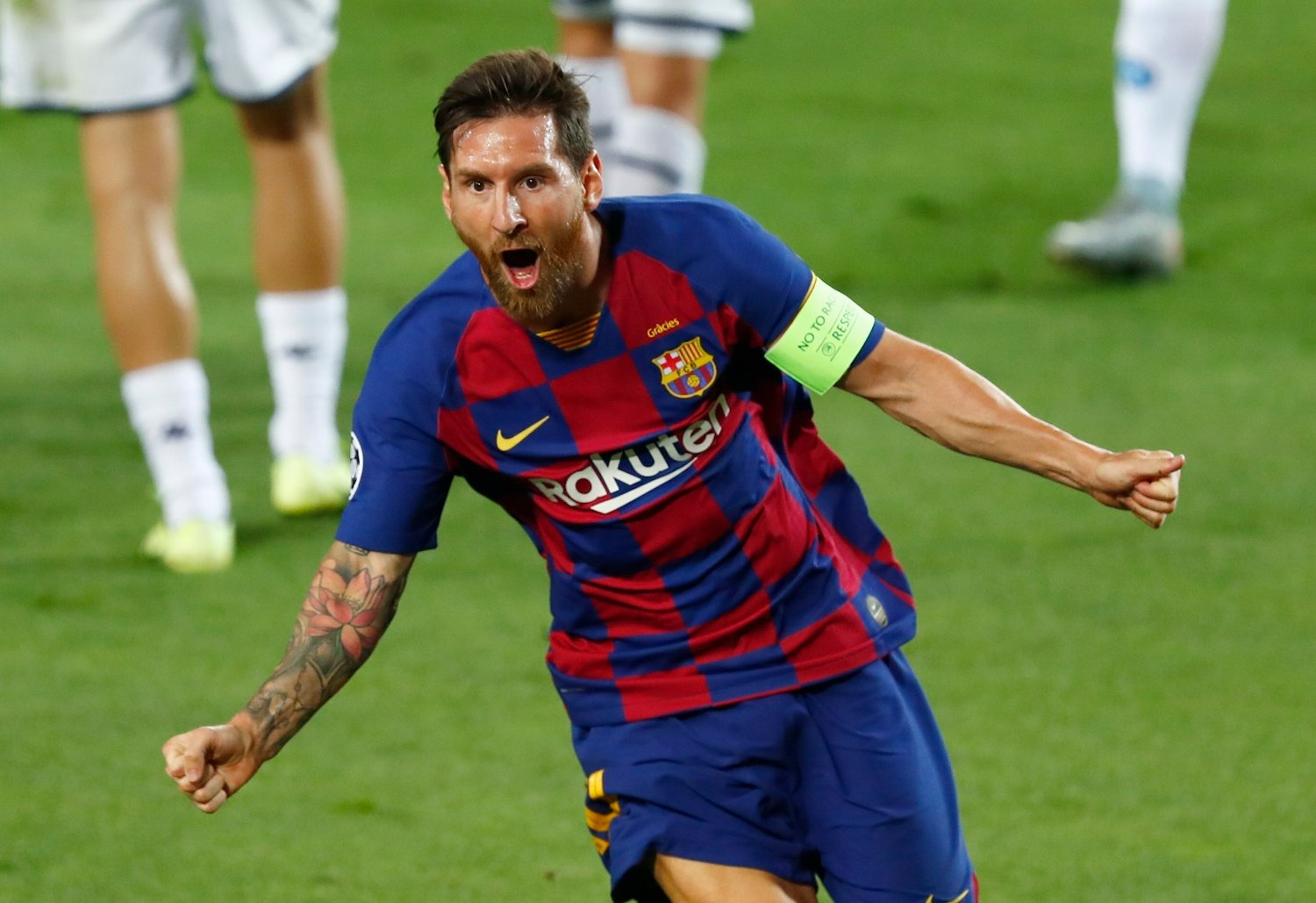 Barcelona's Lionel Messi celebrates after scoring his side's second goal during the Champions League round of 16, second leg soccer match between Barcelona and Napoli at the Camp Nou Stadium in Barcelona, Spain, Saturday, Aug. 8, 2020.