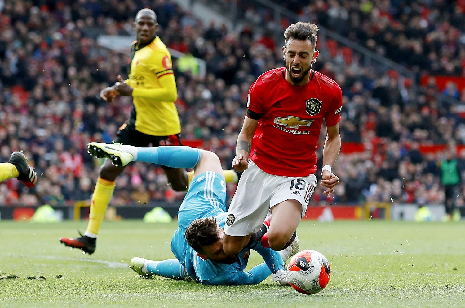 Britain Soccer Premier League Manchester United's Bruno Fernandes is brought down in the penalty area by Watford goalkeeper Ben Foster, during their English Premier League soccer match at Old Trafford in Manchester, England, Sunday Feb. 23, 2020. Fernandes went on to score from the penalty spot.