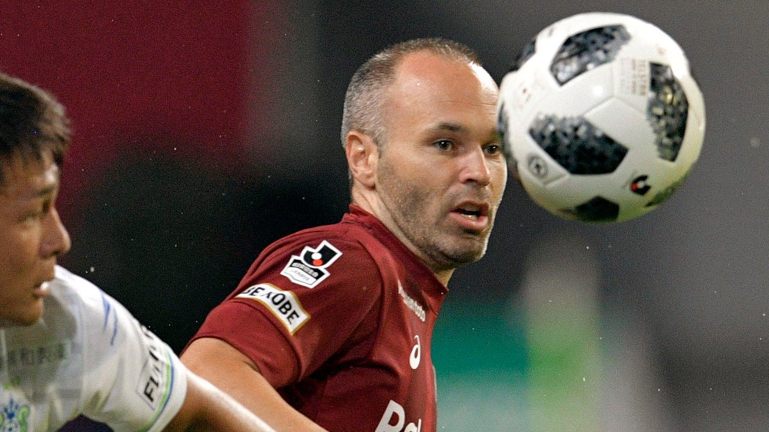 FILE - In this July 22, 2018, file photo, Vissel Kobe's Andres Iniesta, right, of Spain controls the ball during their J-League soccer match against Shonan Bellmare in Kobe, western Japan. Iniesta is confident he can help his struggling Japanese team turn things around after a disappointing start to the season.