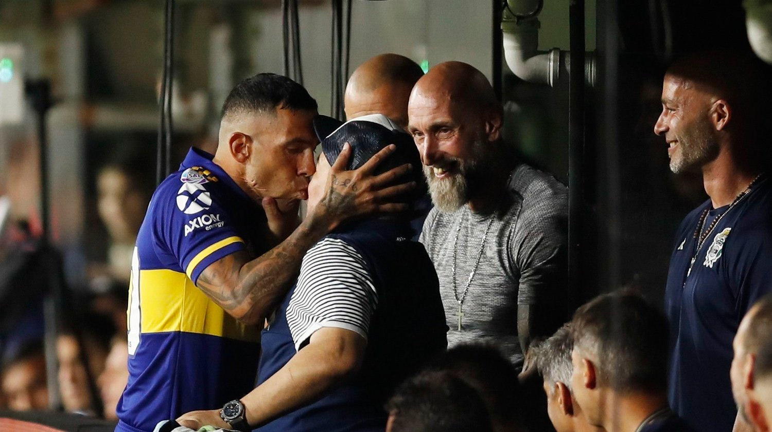 Boca Juniors' Carlos Tevez kisses Gimnasia y Esgrima 's coach Diego Maradona prior to an Argentina's soccer league match at La Bombonera stadium in Buenos Aires, Argentina, Saturday, March 7, 2020.