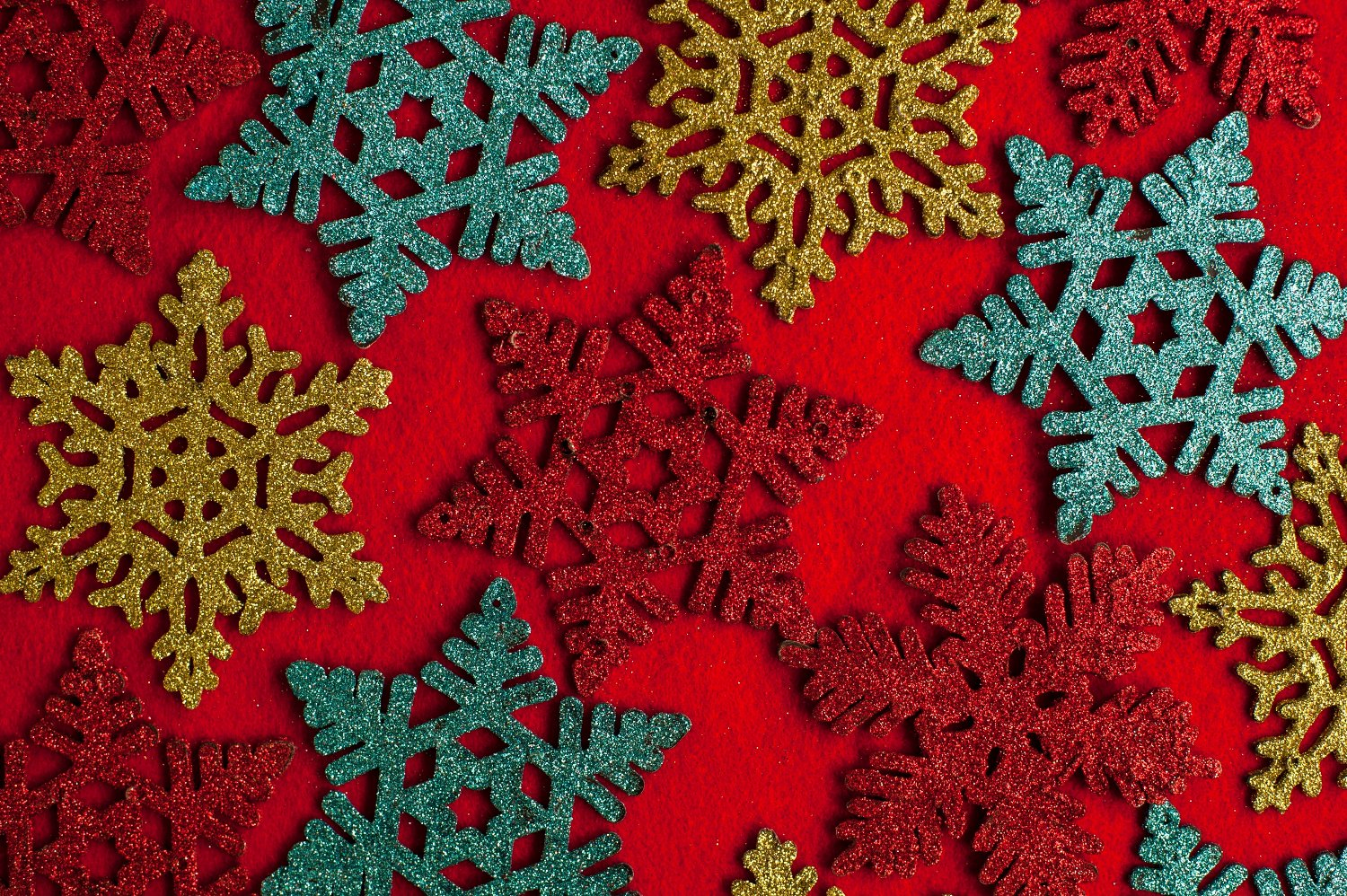 Multi colored Christmas coasters star shaped Multi colored Christmas coasters snow flakes