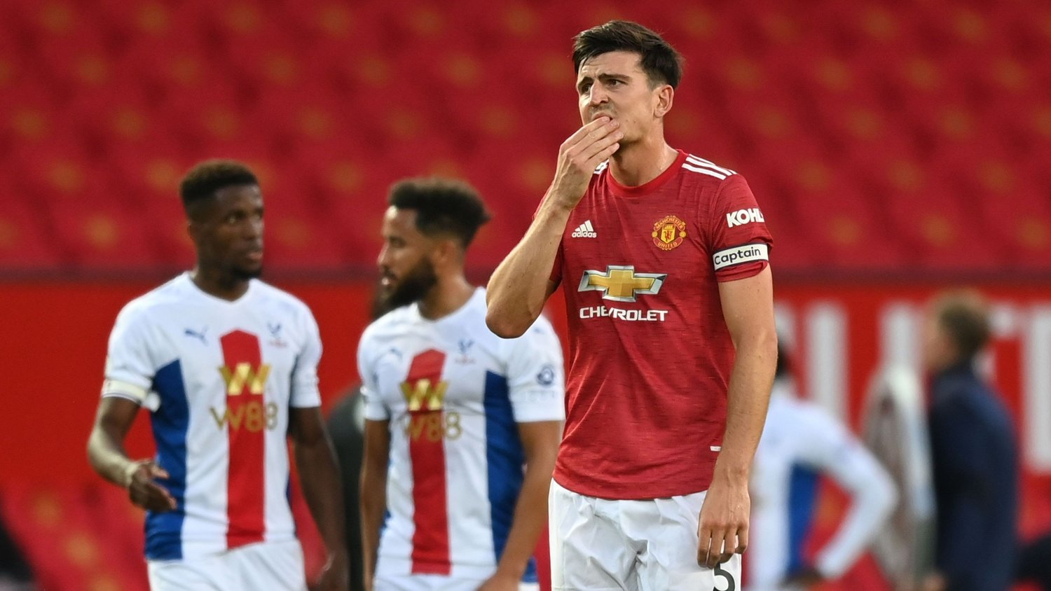 Manchester United's English defender Harry Maguire reacts after a penalty is awarded to Crystal Palace during the English Premier League football match between Manchester United and Crystal Palace at Old Trafford in Manchester, north west England, on September 19, 2020. / RESTRICTED TO EDITORIAL USE. No use with unauthorized audio, video, data, fixture lists, club/league logos or 'live' services. Online in-match use limited to 120 images. An additional 40 images may be used in extra time. No video emulation. Social media in-match use limited to 120 images. An additional 40 images may be used in extra time. No use in betting publications, games or single club/league/player publications. /