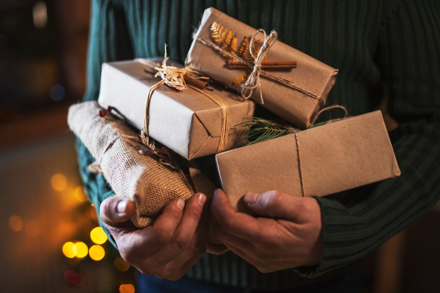 Man Holding Organic Christmas Presents. Unrecognizable male hands holding organic Christmas presents.