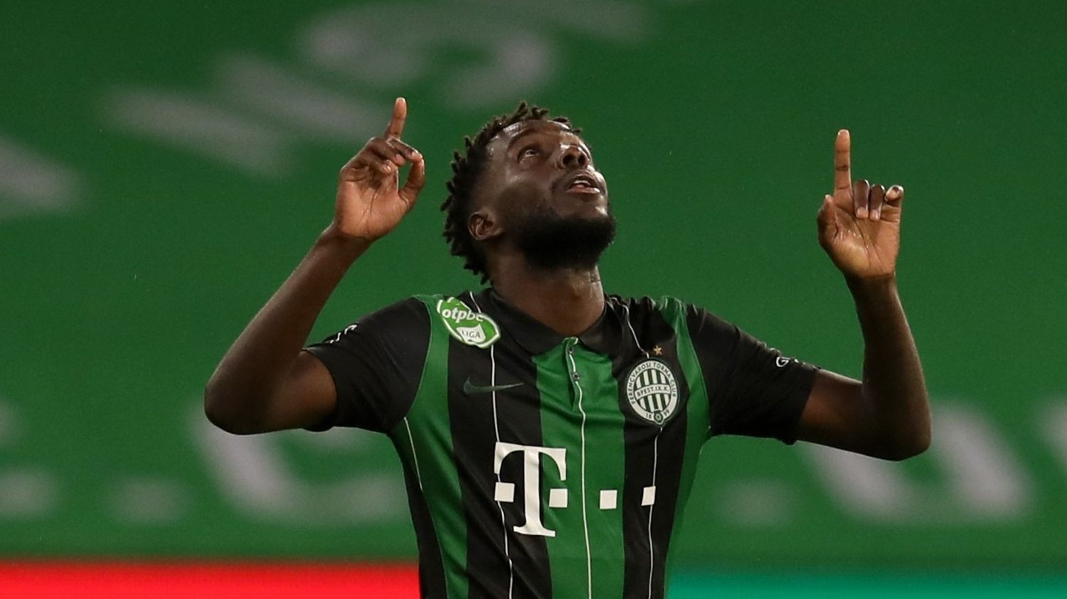 Ferencvaros' Tokmac Nguen celebrates scoring his side's second goal of the game during the UEFA Champions League second qualifying round match at Celtic Park, Glasgow.