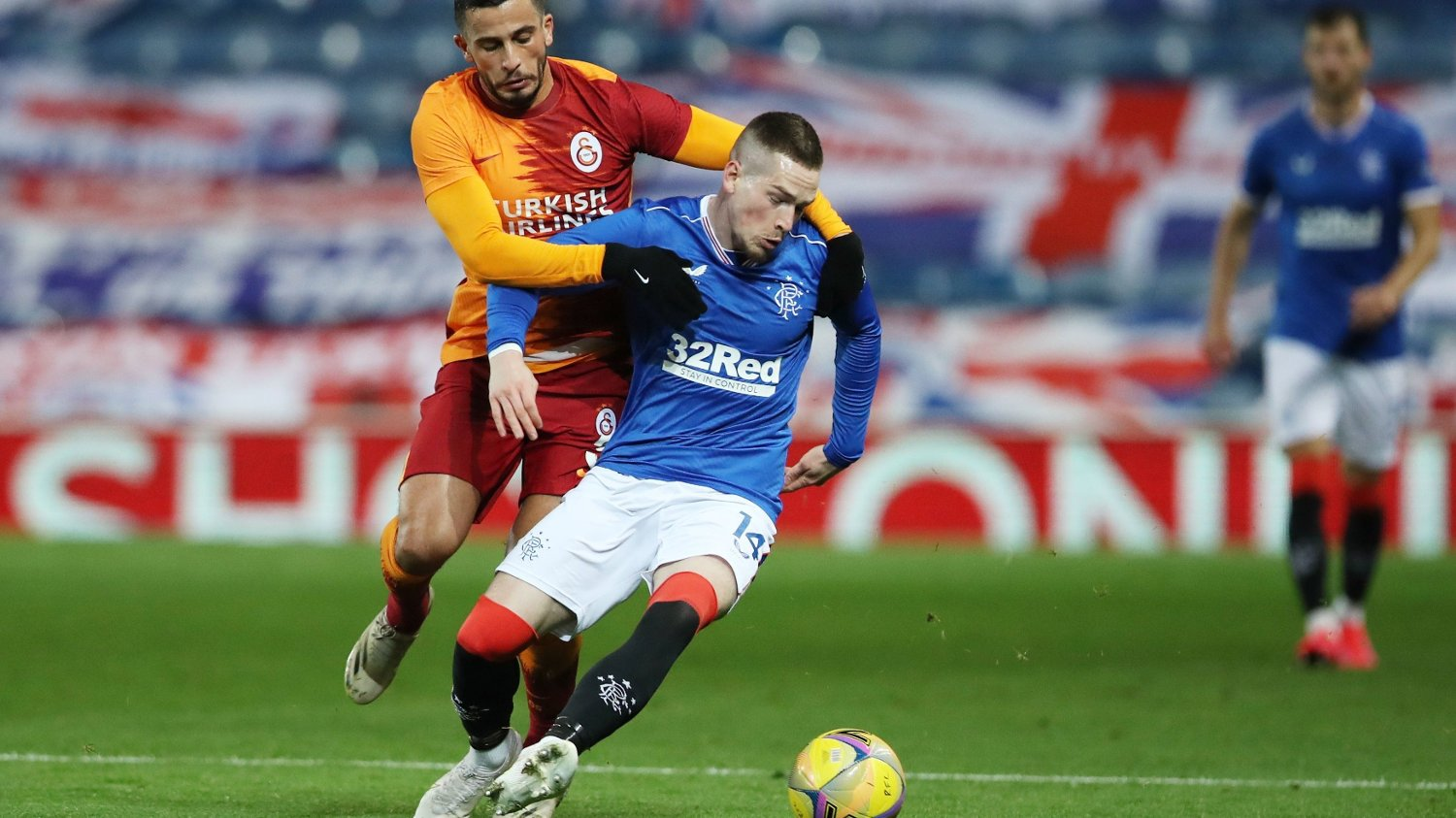Soccer Football - Europa League - Play-off - Rangers v Galatasaray - Ibrox Stadium, Glasgow, Scotland, Britain - October 1, 2020. Rangers' Ryan Kent in action with Galatasaray's Omar Elabdellaoui. Pool via REUTERS/Ian Macnicol