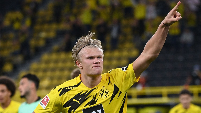 Dortmund's Norwegian forward Erling Braut Haaland celebrates scoring during the German first division Bundesliga football match Borussia Dortmund v Borussia Moenchengladbach in Dortmund, western Germany on September 19, 2020. / DFL REGULATIONS PROHIBIT ANY USE OF PHOTOGRAPHS AS IMAGE SEQUENCES AND/OR QUASI-VIDEO