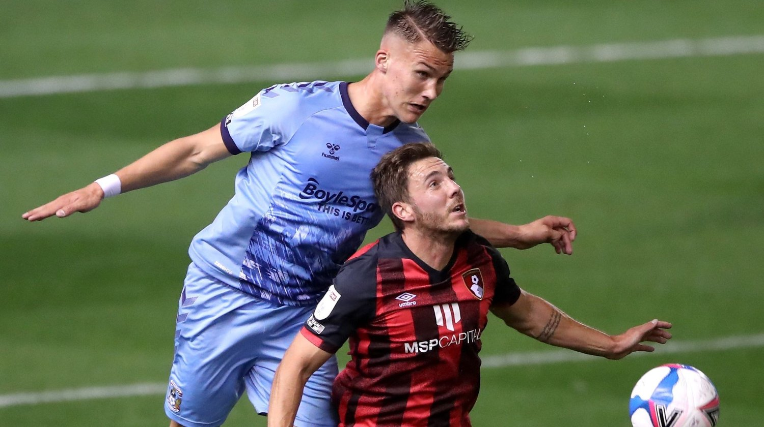 Coventry City's Leo Ostigard and AFC Bournemouth's Dan Gosling battle for the ball during the Sky Bet Championship match at St Andrew's Trillion Trophy Stadium, Birmingham.