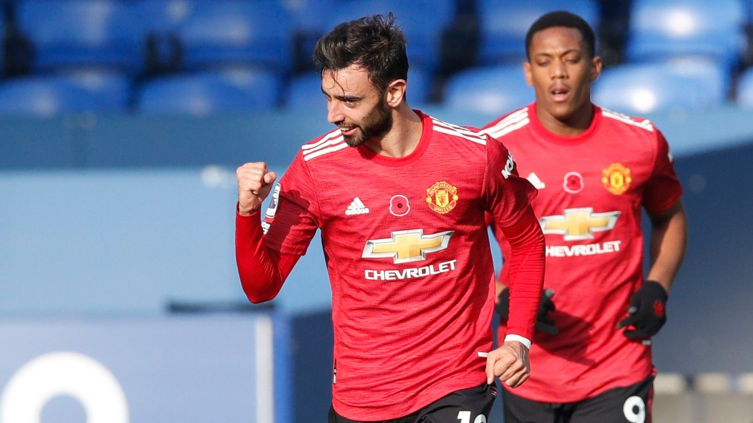 Manchester United's Bruno Fernandes celebrates after scoring his side's opening goal during the English Premier League soccer match between Everton and Manchester United at the Goodison Park stadium in Liverpool, England, Saturday, Nov. 7, 2020.