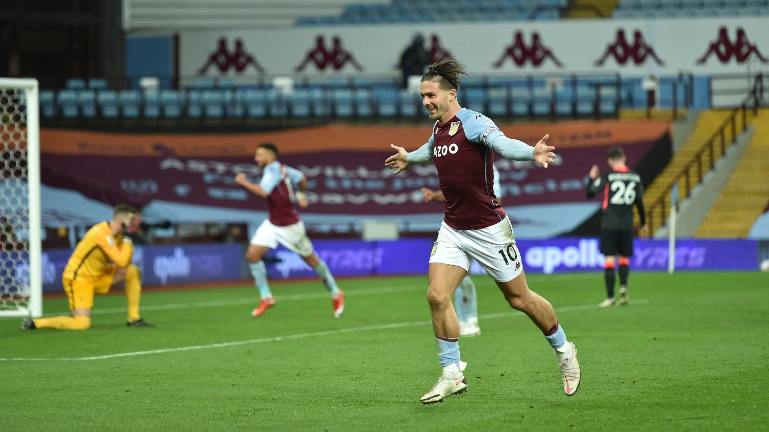 Aston Villa's Jack Grealish celebrates after scoring his side's sixth goal during the English Premier League soccer match between Aston Villa and Liverpool at the Villa Park stadium in Birmingham, England, Sunday, Oct. 4, 2020.