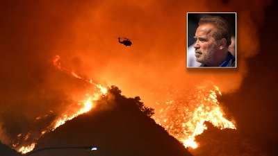 A firefighting helicopter flies over the Getty Fire as it burns in the hills west of the 405 freeway in the hills of West Los Angeles, California A firefighting helicopter flies over the Getty Fire as it burns in the hills west of the 405 freeway in the hills of West Los Angeles, California, U.S. October 28, 2019. REUTERS/Gene Blevins