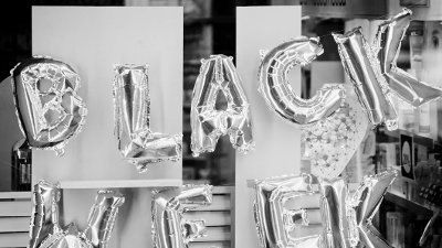 Black week sign made of silver helium balloons Black week sign made of silver helium balloons. Detail of a store window in A Coruña, Galicia, Spain.