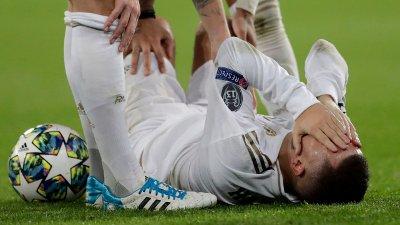 Real Madrid's Eden Hazard reacts injured at the ground during a Champions League soccer match Group A between Real Madrid and Paris Saint Germain at the Santiago Bernabeu stadium in Madrid, Spain, Tuesday, Nov. 26, 2019.