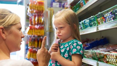 Child Having Arguement With Mother At Candy Counter Discipline problems whilst shopping