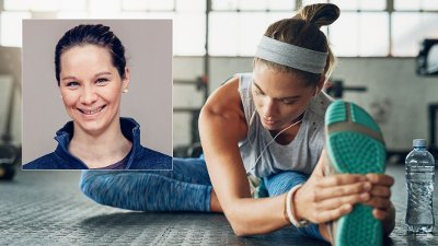She aspires to inspire fitness in herself everyday Shot of a young attractive woman stretching in a gym