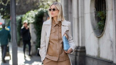 Street Style: February 20th - Milan Fashion Week Fall/Winter 2020-2021 MILAN, ITALY - FEBRUARY 20: Linda Tol is seen wearing trench brown button shirt, shorts outside Max Mara during Milan Fashion Week Fall/Winter 2020-2021 on February 20, 2020 in Milan, Italy.