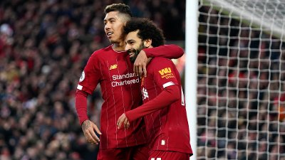 Liverpool's Mohamed Salah, right, celebrates with Liverpool's Roberto Firmino after scoring his sides third goal during the English Premier League soccer match between Liverpool and Southampton at Anfield Stadium, Liverpool, England, Saturday, February 1, 2020.