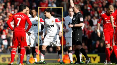 Manchester United's Rafael, center left, is shown a yellow card by referee Phil Dowd after a tussle with Liverpool's Martin Skrtel, right, who also received a booking for his part in the incident during their English Premier League soccer match at Anfield Stadium, Liverpool, England, Sunday March 6, 2011. LICENCE. EMAIL info@football-dataco.com FOR DETAILS.