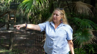 Tiger King-Missing Man FILE - In this July 20, 2017 file photo, Carole Baskin, founder of Big Cat Rescue, walks the property near Tampa, Fla. Baskin was married to Jack Don Lewis, whose 1997 disappearance remains unsolved and is the subject of a new Netflix series Tiger King.