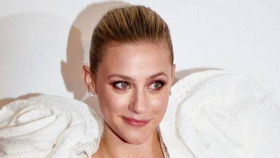 TIFF: Red carpet for 'Hustler' with Jennifer Lopez, Constance Wu and Cardi B as revengeful strippers Actress Lili Reinhart arrives for the premiere of