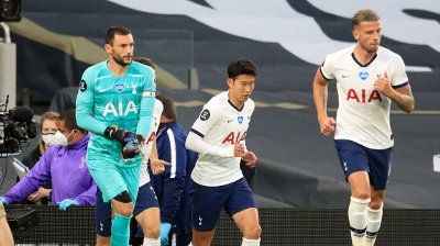 TALK UP: Son Heung-min and Hugo Lloris gave each other a good hug before running out on the mat after the rest.
