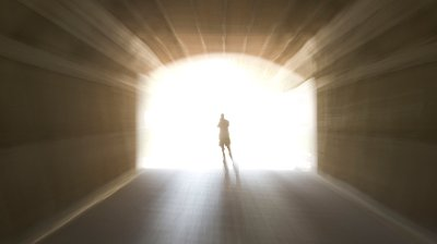 Go to the bright surreal tunnel with bright light with a shadowy figure at the end