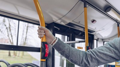 Man in mask and protective gloves traveling by city bus during coronovirus covid-19 Man in mask and protective gloves traveling by city bus during coronovirus covid-19 pandemic