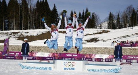 TRIPPEL: therese Johaug, Marit Bjørgen og Kristin Størmer Steira på pallen etter tremila.