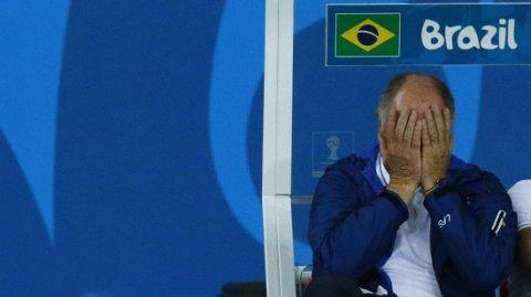 GJEMTE SEG: Luiz Felipe Scolari forsøkte det gamle trikset med å holde seg for øynene og håpe at noe vondt skulle bli borte. Det fungerte ikke.