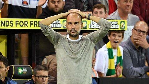 Manchester City-manager Pep Guardiola depper etter tapet mot Norwich sist sesong. Det var et sjokktap, og vi tror de lyseblå går på en ny smell i serieåpningen borte mot Wolves.