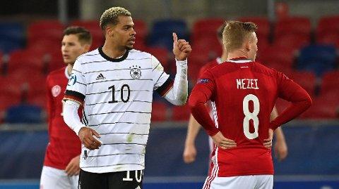 Lukas Nmecha har scoret ett av målene da Tyskland slo Ungarn på kvartfinale-arenaen i gruppespillet.