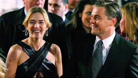 HÅND I HÅND: Kate Winslet og Leonardo DiCaprio hånd i hånd på premieren i London.
