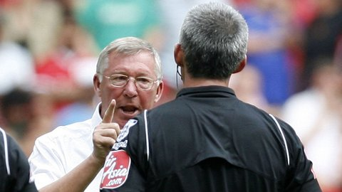 Sir Alex Ferguson of Manchester United (L) gestures to referee Chris Foy at the final whistle during the FA Community Shield at Wembley Stadium in London, England on August 9, 2009.