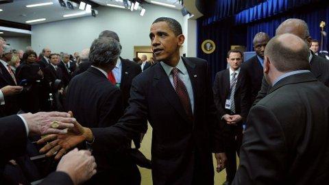 President Barack Obama møter deltagere på en jobbkonferanse i Washington 3. desember 2009.