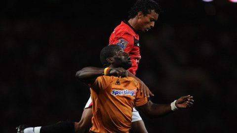 Wolverhampton Wanderers' Cameroon defender George Elokobi (down) and Manchester United's Portugese midfielder Nani compete for the ball during their English League Cup football match at Old Trafford in Manchester, north-west England, on September 23, 2009