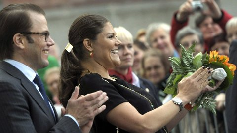 Sweden's Crown Princess Victoria and Prince Daniel clap as they meet crowds at a local market place in Turku, Finland Tuesday Sept. 20, 2011. The Swedish Crown Princess and her husband visit Turku, Finland, the European Capital of Culture 2011, for two days.