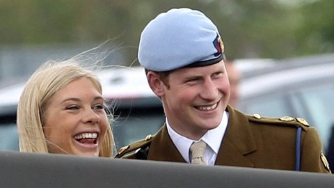 ANDOVER, ENGLAND - MAY 07: Prince Harry and Chelsy Davy laugh as they attend Prince Harry's Pilot Course Graduation at the Army Aviation Centre on May 7, 2010 in Andover,