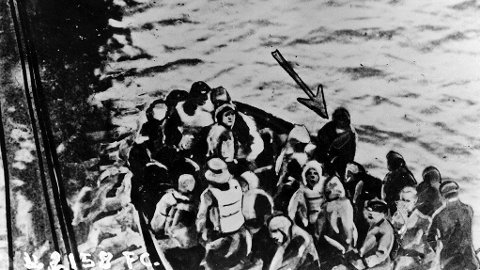 14th April 1912: Survivors of the 'Titanic' disaster nearing the 'Carpathia', in a lifeboat. The arrow points to Joseph Bruce Ismay, chairman of the White Star Line.