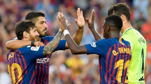 Lionel Messi styrte Barcelona til storseier. Her sammen med Luis Suarez og Ousmane Dembele.
