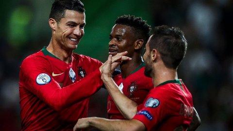 Cristiano Ronaldo og Bernardo Silva scoret hvert sitt mål da Portugal slo Luxembourg 3-0 hjemme fredag. I midten ser vi Nelson Semedo.