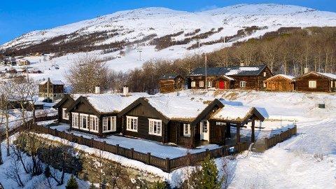 NEST DYREST: Denne hytten i Vangslia er med en prisantydning på 8.990.000 kroner den nest dyreste hytten for salg i Oppdal.