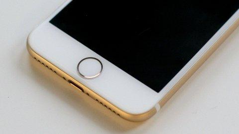 Det sies at iPhone SE 2020 har en tradisjonell hjemknapp. Bildet viser hjemknappen på en tidligere iPhone-modell.