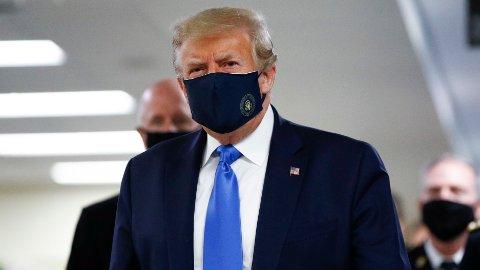 SMITTEOPPBLOMSTRING: En rask økning i antall smittetilfeller kan føre til ny nedstenging av det amerikanske samfunnet og flere arbeidsledige, til Donald Trumps fortvilelse. (AP Photo/Patrick Semansky)