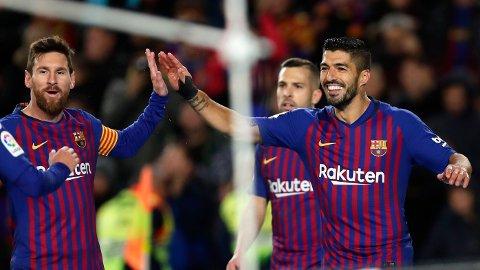 TIDLIGERE LAGKAMERATER: Lionel Messi er ikke glad for at Luis Suarez er ferdig i klubben.