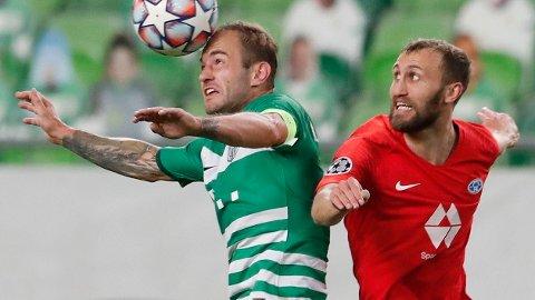 TETT OG TØFT: Gergo Lovrencsics i duell med Magnus Wolff Eikrem underveis i Champions League-playoffen.