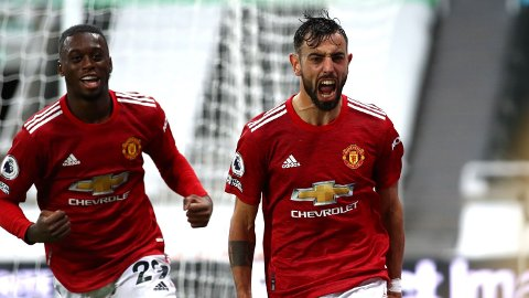 Manchester United's Bruno Fernandes (right) celebrates scoring his side's second goal of the game during the Premier League match at St James' Park, Newcastle.