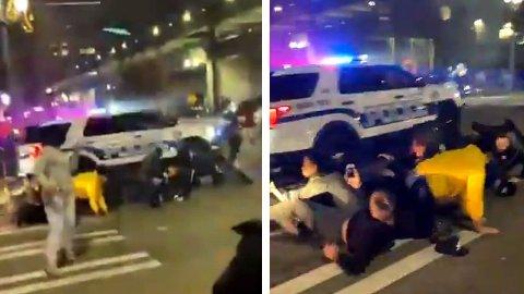 Videoen viser at politibilen treffer en rekke mennesker før det kjører over en person to ganger.